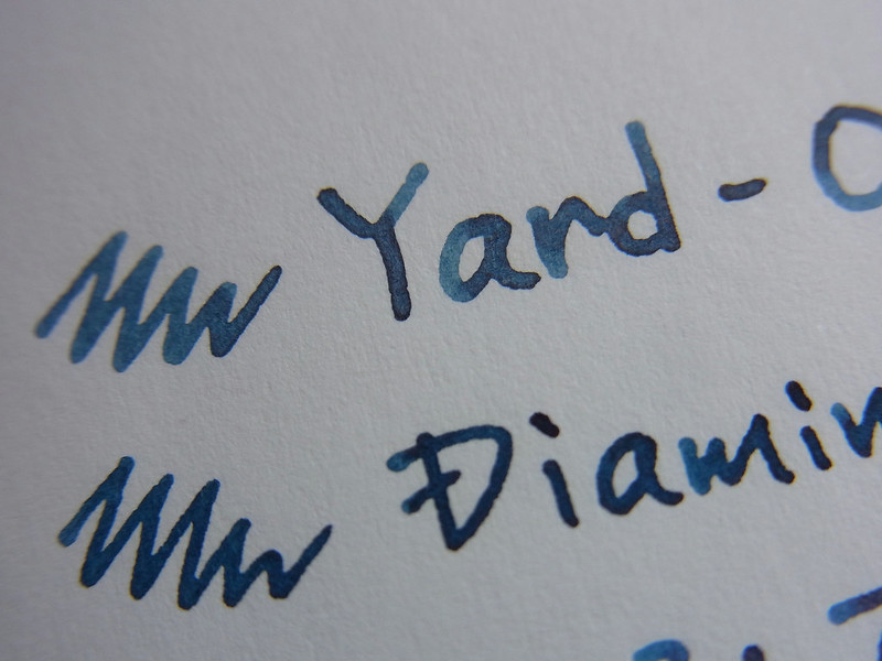 YARD-O-LED Blue Black handwriting 1