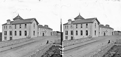 """Modern building, possibly an hotel with """"Butler"""" shop attached (is Lisdoonvarna)"""