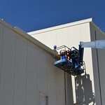 Blue Grass Chemical Agent-Destruction Pilot Plant workers install gutters outside the Explosive Destruction Technology Enclosure Building. Once operational, this facility will augment the main plant to destroy approximately 15,000 155mm projectiles containing mustard agent.