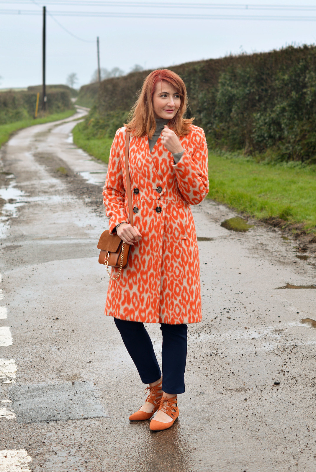 Orange animal print coat with navy | Not Dressed As Lamb
