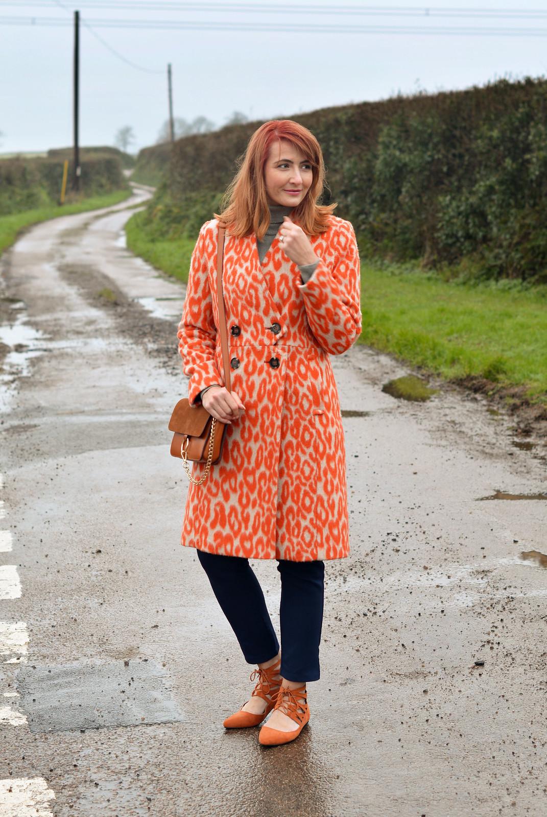 Orange animal print coat with navy   Not Dressed As Lamb