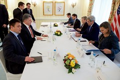 U.S. Secretary of State John Kerry, Ukrainian President Petro Poroshenko, and their respective advisers look over their briefing papers before a bilateral meeting on February 13, 2016, at the Bayerischer Hof Hotel in Munich, Germany, on the sidelines of the Munich Security Conference. [State Department photo/ Public Domain]