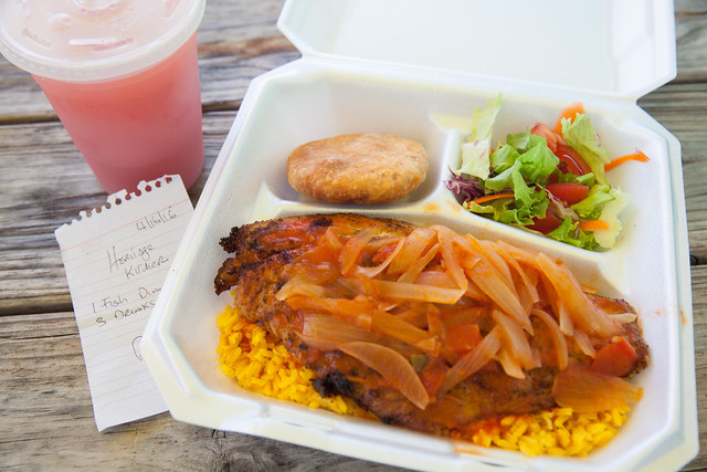 Cayman style red snapper on Spanish rice, fried dough bread and side salad and my guava juice
