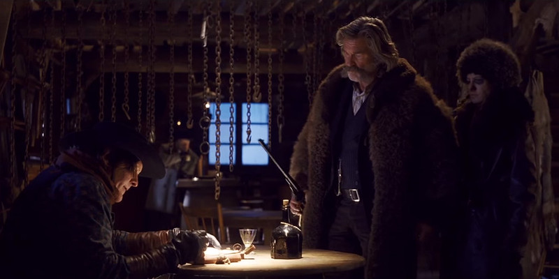 Kurt Russell and Jennifer Jason Leigh have a terse conversation with Michael Madsen, just three of THE HATEFUL EIGHT.