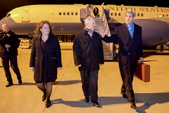 U.S. Secretary of State John Kerry walks with U.S. Embassy Berlin Deputy Chief of Mission Kent Logsden and U.S. Consulate General Munich Consul General Jennifer Gavito after disembarking from his airplane on February 10, 2016, following a flight from Andrews Air Force Base in Camp Springs, Maryland, to Munich International Airport in Munich, Germany, so he can attend meetings focused on Syria and also address the Munich Security Conference. [State Department photo/ Public Domain]