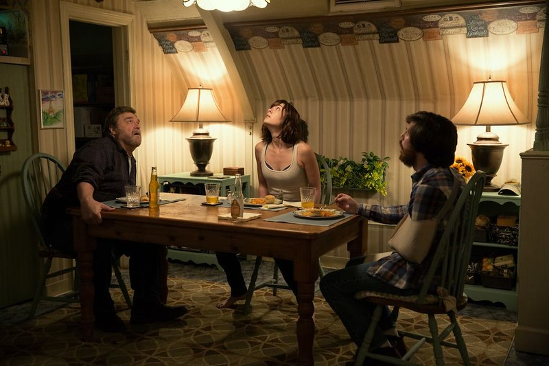 John Goodman, Mary Elizabeth Winstead and John Gallagher Jr. hunker in a bunker away from an unknown threat in 10 CLOVERFIELD LANE.