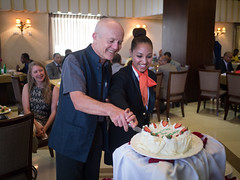 Mick Moore accepts a cake from the hotel