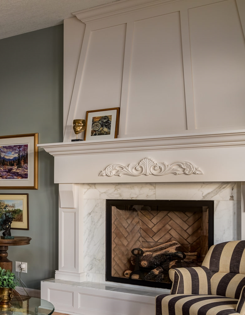 fireplace renovation adds a modern touch to a dated family room