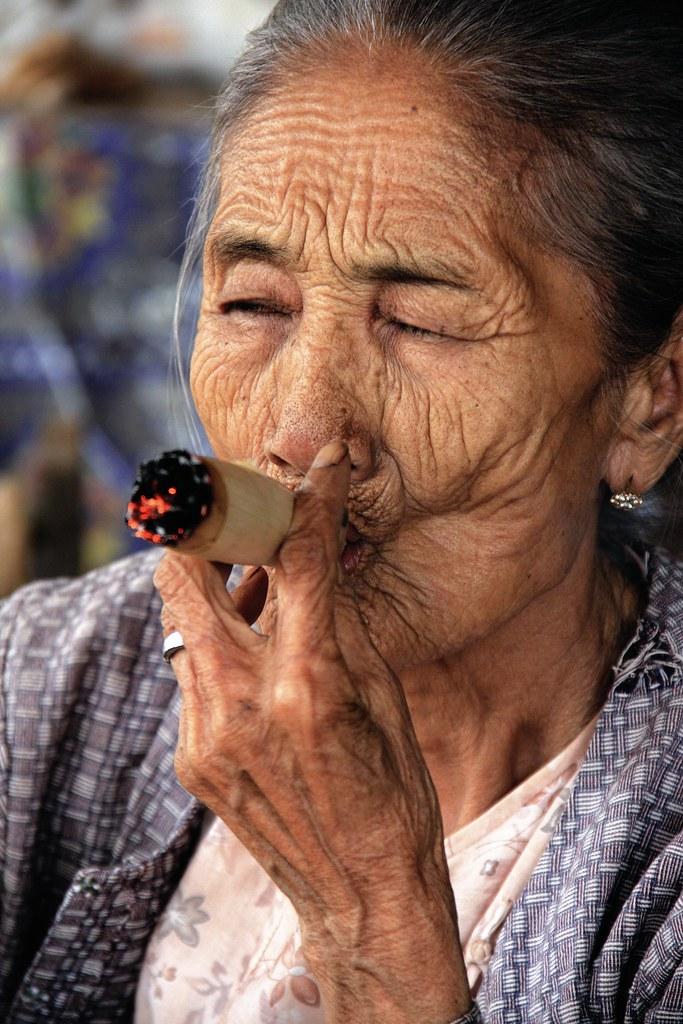 Smoking A Cheroot Cigar In Burma