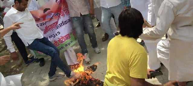 Effigy Burning in protest of land acquisition bill by youth congress members.
