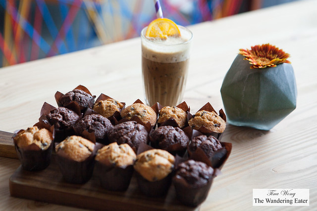 Mini chocolate muffins and iced orange latte