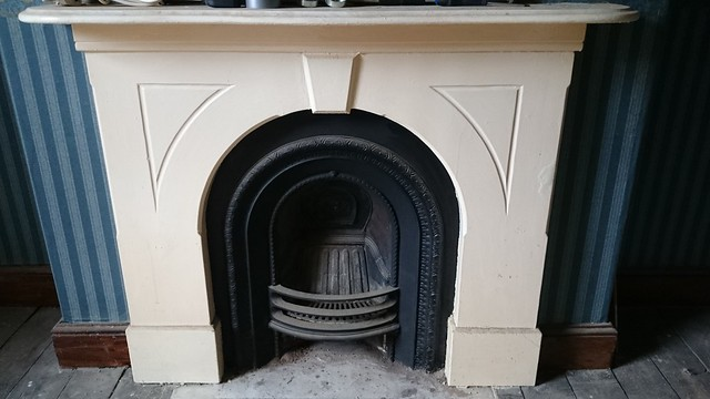 Fireplaces in my sister's new house, awaiting restoration.