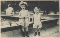 Young children standing next to a fountain