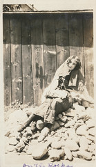 Woman sits on a pile of rocks