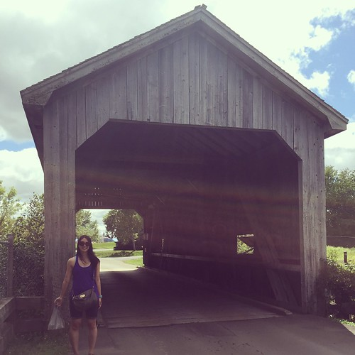 Mei with a covered bridge.