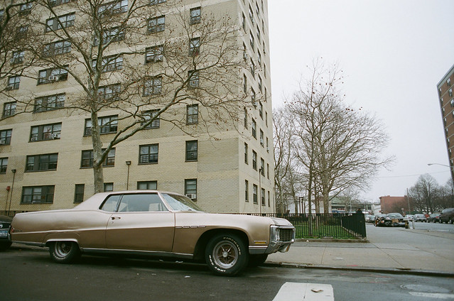 Beige car and building