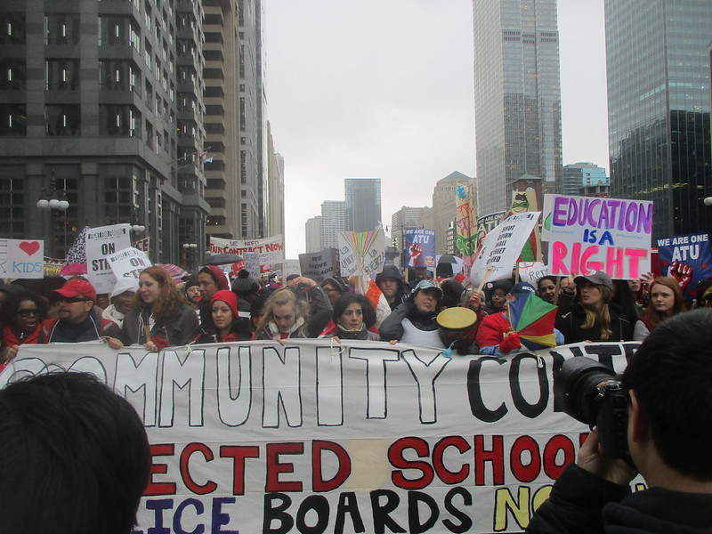 CTU March - Walking east on Wacker -Banner in front of the rally