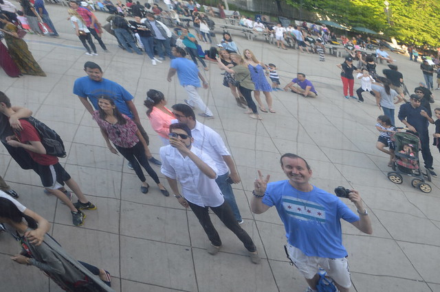 Ryan Janek Wolowski reflecting in the The Cloud Gate by Anish Kapoor in Millennium Park, Chicago, Illinois, USA