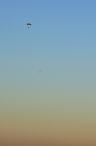 Skydiver over Montes de Alvor at sunset