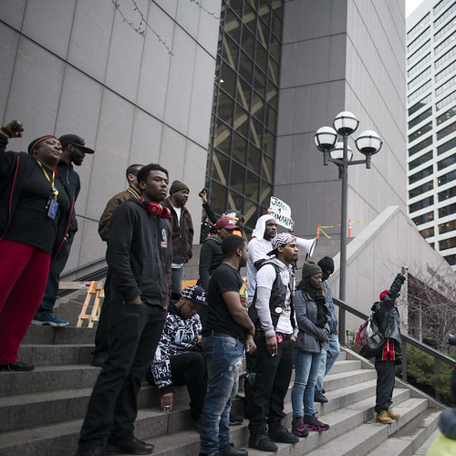 Protesters react to the decision to not prosecute the police for the death of Jamar Clark