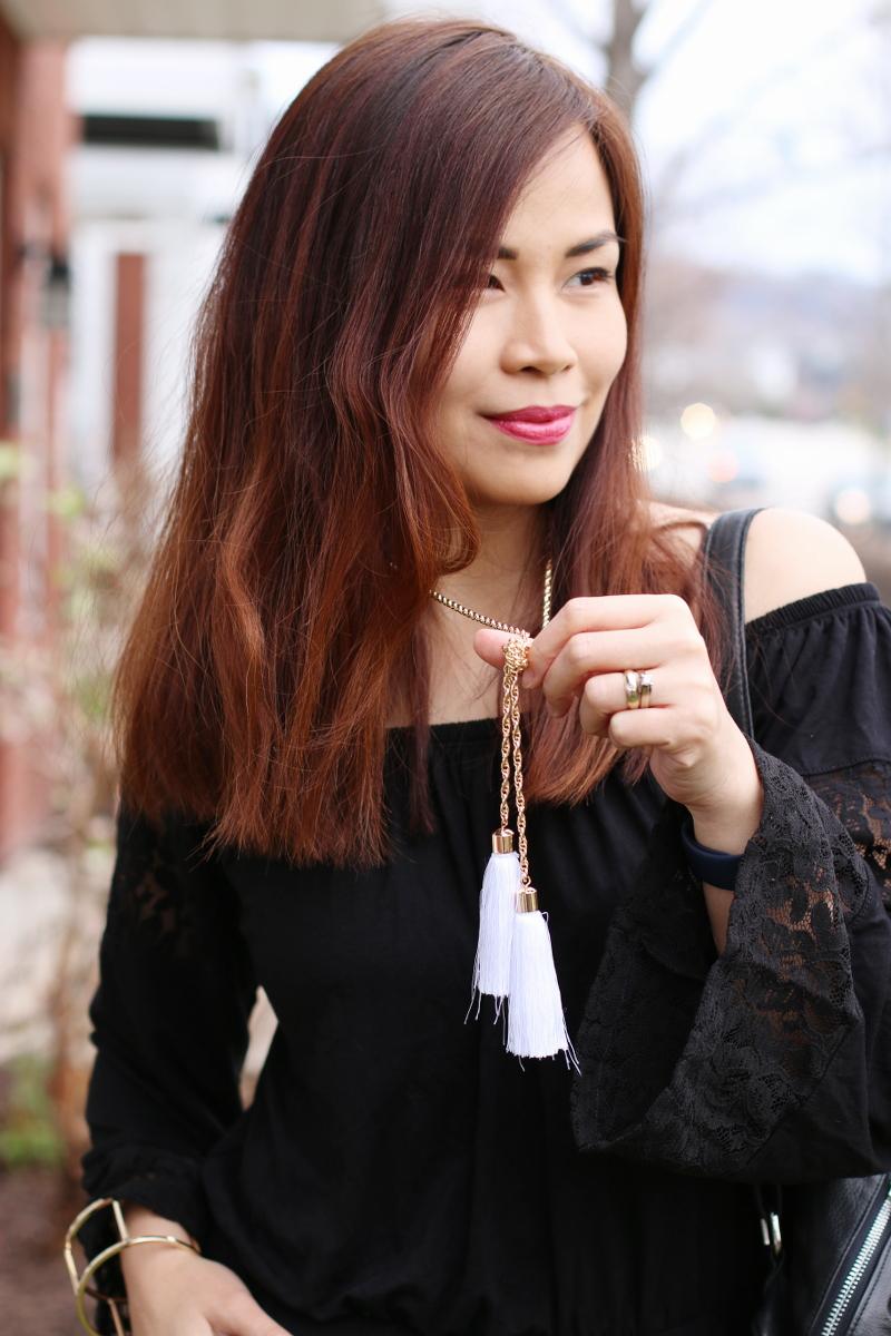 white-tassel-necklace-black-romper-7