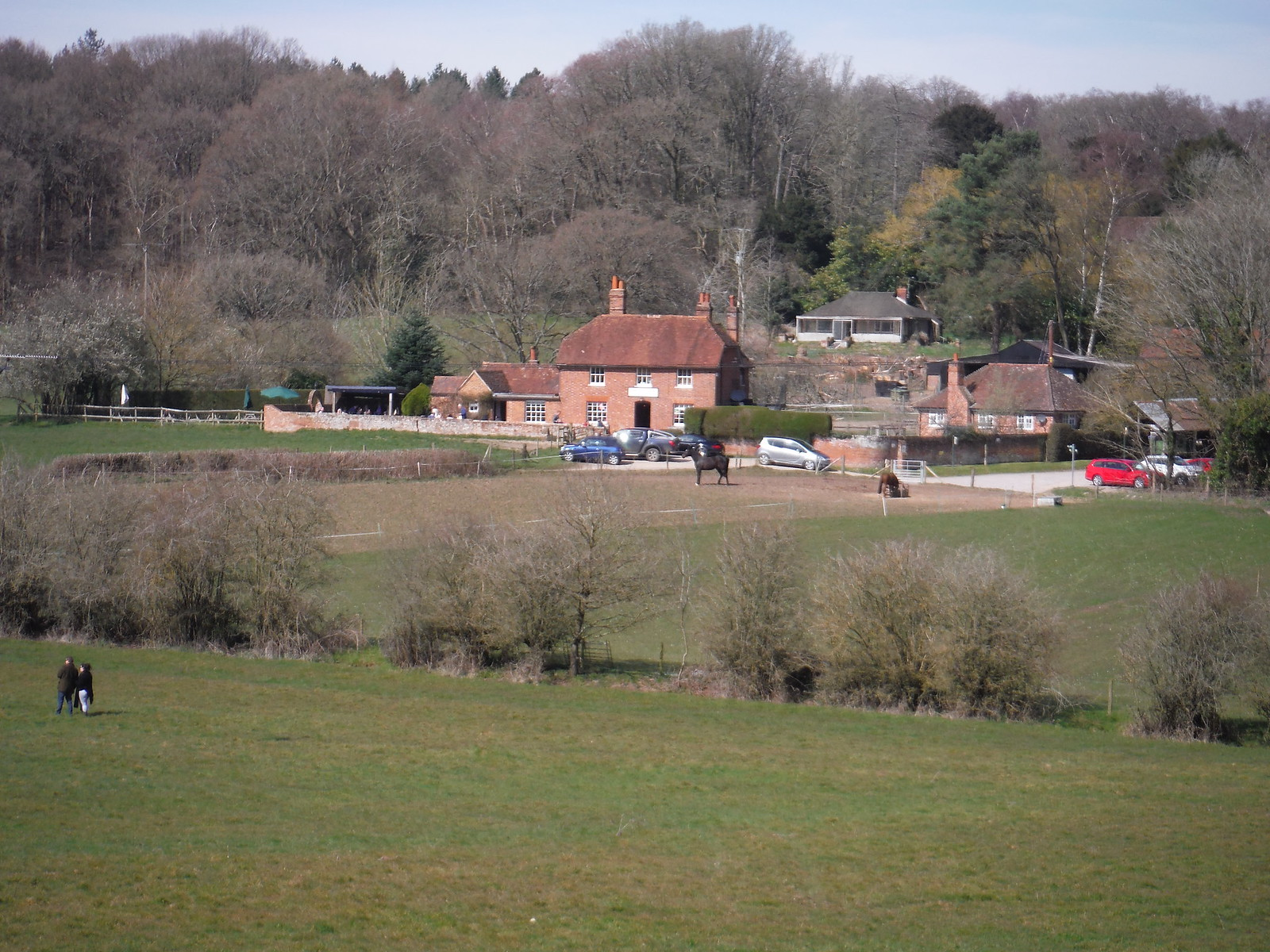 The Pot Kiln pub across a meadow SWC Walk 260 Aldermaston to Woolhampton [Midgham Station] (via Frilsham)