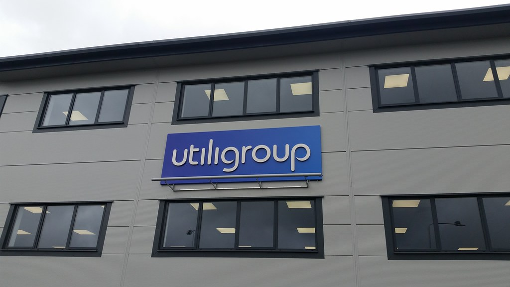 3D built up stainless steel letters mounted on an aluminium sign tray covered in digital print.  LED uplighter.