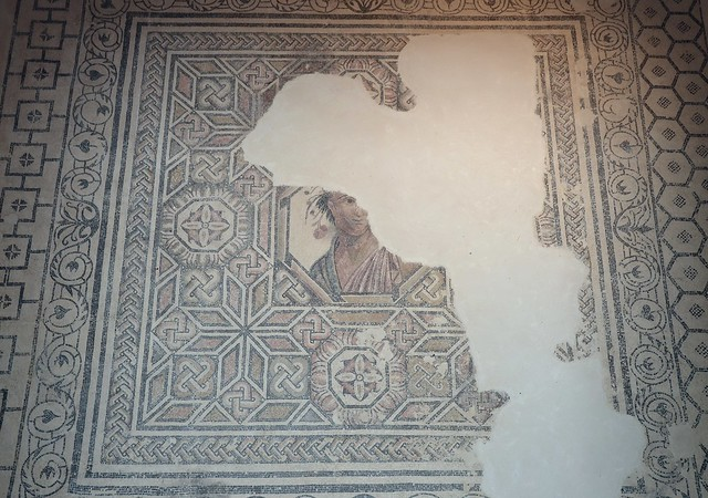 Mosaic floor with a central octagonal medallion portrait, probably an allegory of Spring, that paved the oecus of the Villa del Alcaparral, Roman Mosaic Museum, Casariche, Spain