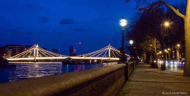 Chelsea embankment at night looking over Thames