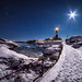 Moon vs lighthouse by Richard Larssen