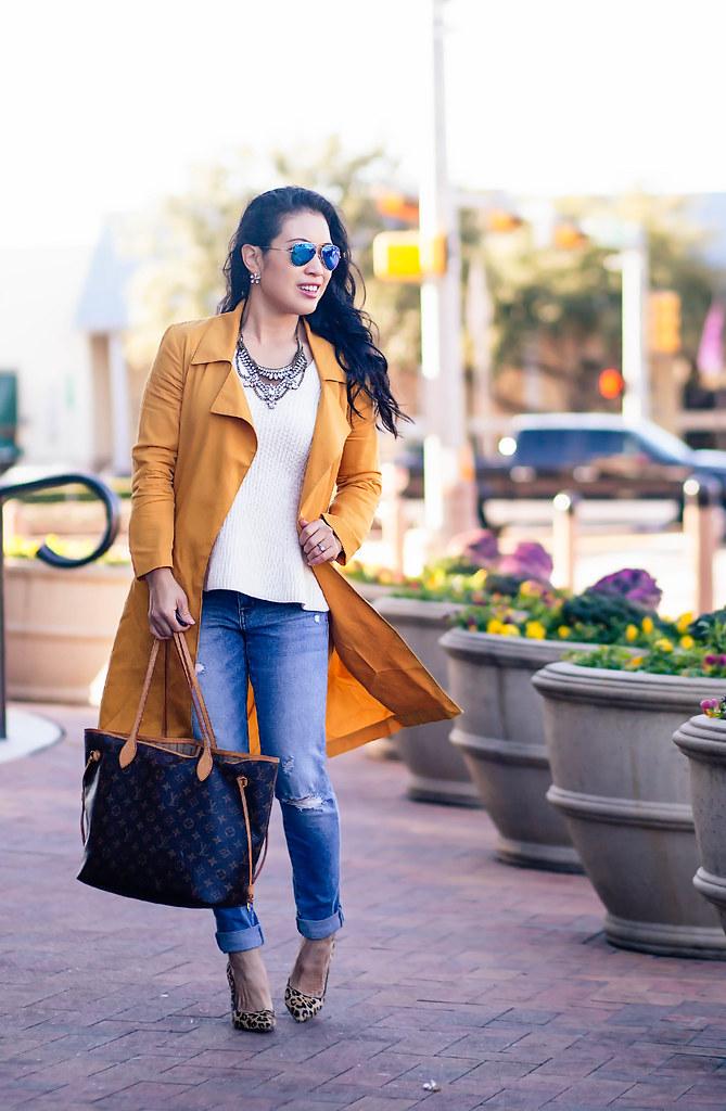 cute & little blog | mustard waterfall drape trench coat, white peplum knit sweater, distressed boyfriend jeans, leopard pumps, rayban blue mirror flash aviators, louis vuitton neverfull gm | spring outfit