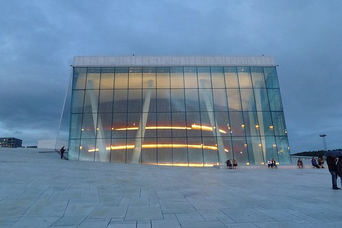 glass oslo twilight dusk illuminated marble operahouse cultural modernity oslohaven