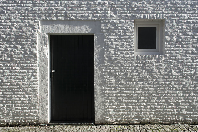 White wall and black door