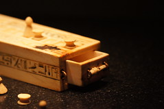 A game box and pieces for playing the game of Senet
