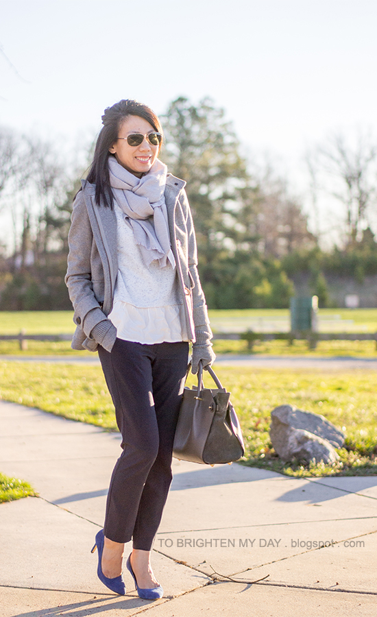 gray toggle coat, gray scarf, gray ruffled sweater, navy pants, gray gloves, blue suede pumps