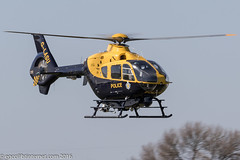 G-LASU - 2002 build Eurocopter EC135 T2+, departing down Runway 08 at Barton