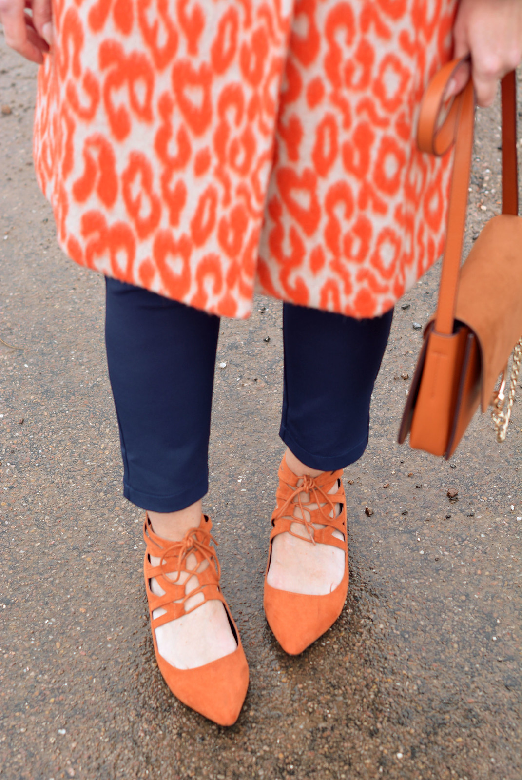 Orange animal print coat, navy trousers, orange lace-up flats| Not Dressed As Lamb