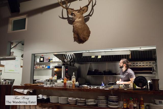Open kitchen with Chef Tobias Grignon working