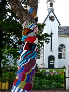 Knit Knot Tree in front of the Katse Church. Yarn bombing in Kats Zeeland the Netherlands