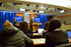 With Deputy Secretary for Management and Resources Heather Higginbottom looking on, USAID Administrator Gayle Smith discusses the assistance portion of the President's FY 2017 Budget Request for the U.S. Department of State and USAID during the Daily Press Briefing at the U.S. Department of State in Washington, D.C., on February 9, 2015. [State Department photo/ Public Domain]