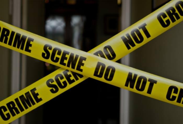 Crime scene tape in front of a door