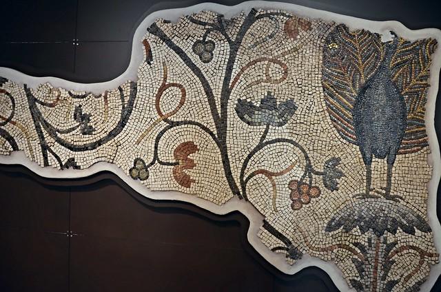 Mosaic fragment depicting a peacock, found on the floor of the corridor connecting the Basilica and the Chromatius Hall, Basilica di Santa Maria Assunta, Aquileia, Italy