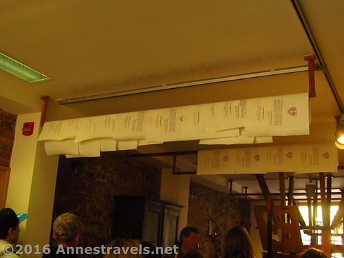 Sheets of printed paper dry on racks hung from the ceiling of the printing office, Franklin Court, Independence National Historic Park, Philadelphia, Pennsylvania