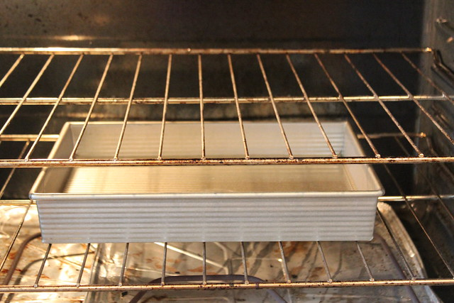 Prepare a water bath by placing water in a baking dish and placing it on one of the lower racks in the oven while it preheats.
