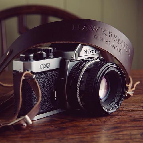 Our brown Borough camera neck strap with the elegant Nikon FM2.