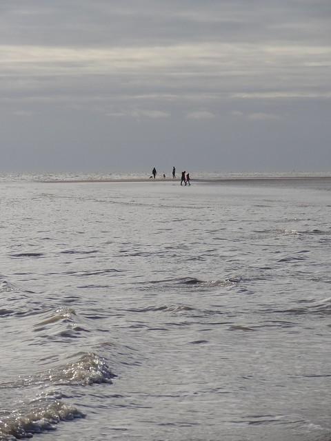 Sunday strollers enjoying the beach between Walton and Frinton
