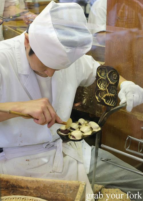 Making taiyaki fish cakes filled with red bean paste at Nakamise, Sensoji Temple, Asakusa, Tokyo