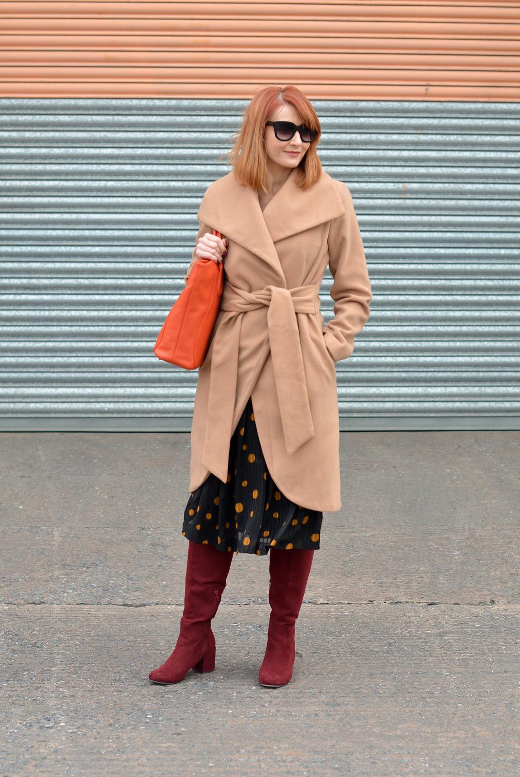 Camel wrap coat, vintage 70s polka dots dress, burgundy boots, orange tote | Not Dressed As Lamb