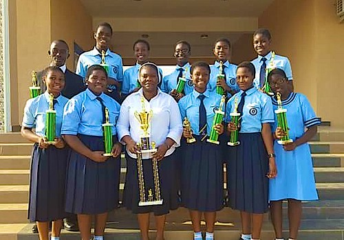 Principal Christie Adegoroye SSL, pictured with the Juilly Tigers, the St Louis Girls Secondary School Abuja Basketball team, after they won a major basketball tournament organised for the private secondary schools in the Abuja metropolitan area