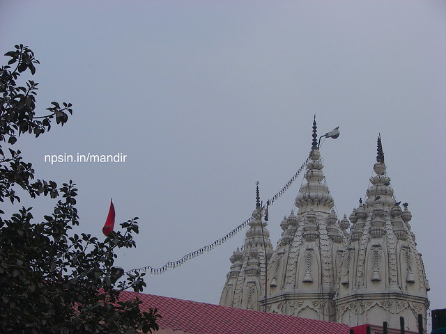 A high, whitewashed three Shikhars are visible from 1 KM distance in both side of road.